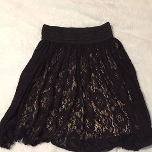 black lace skirt with attached cream slip